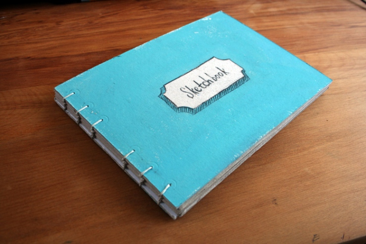 my lovely blue painted sketchbook :)